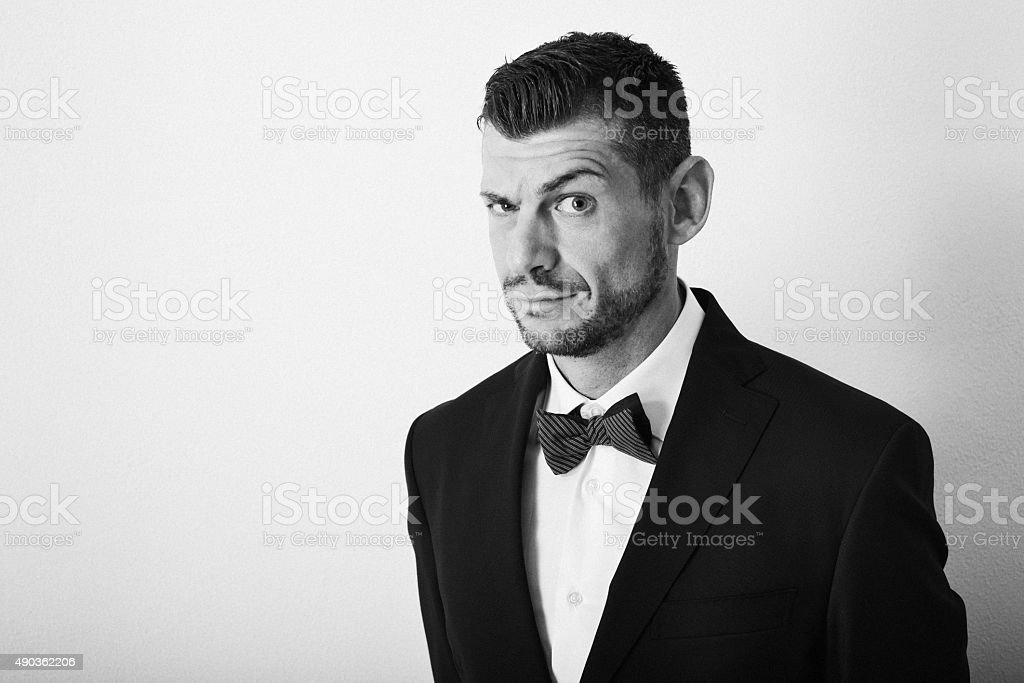 Sly, crafty, elegant man looks at the camera - copyspace stock photo