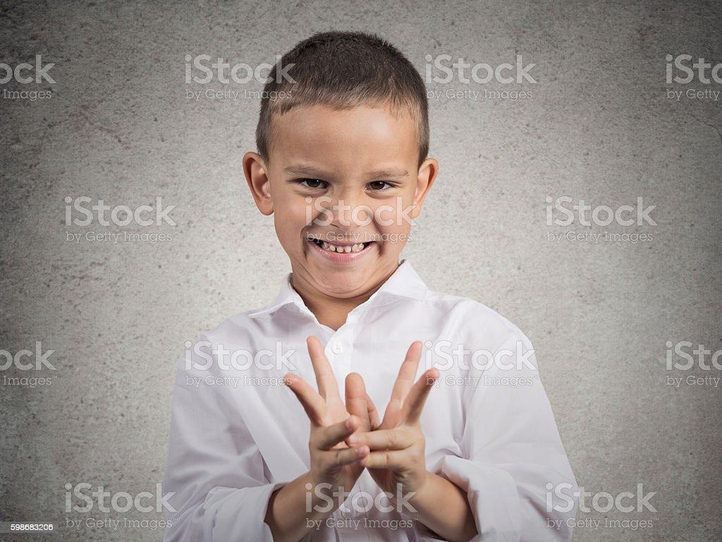sly scheming child boy plotting something bad stock photo