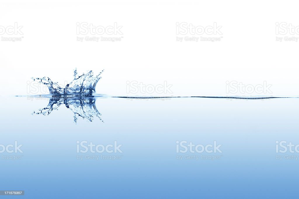 Smal splashing on calm surface of the water stock photo