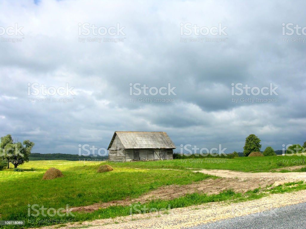 Small, Abandoned Wooden Farm House stock photo