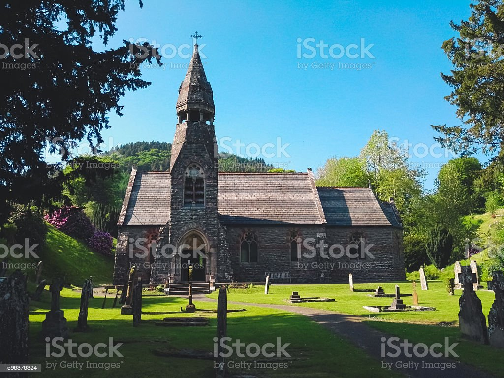 Small abbey and cemetery stock photo