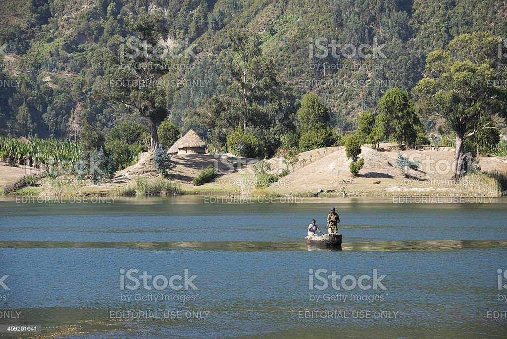 Small african boat with two young men royalty-free stock photo