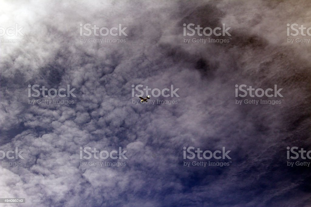 Small Aircraft Against Cloudy Sky stock photo