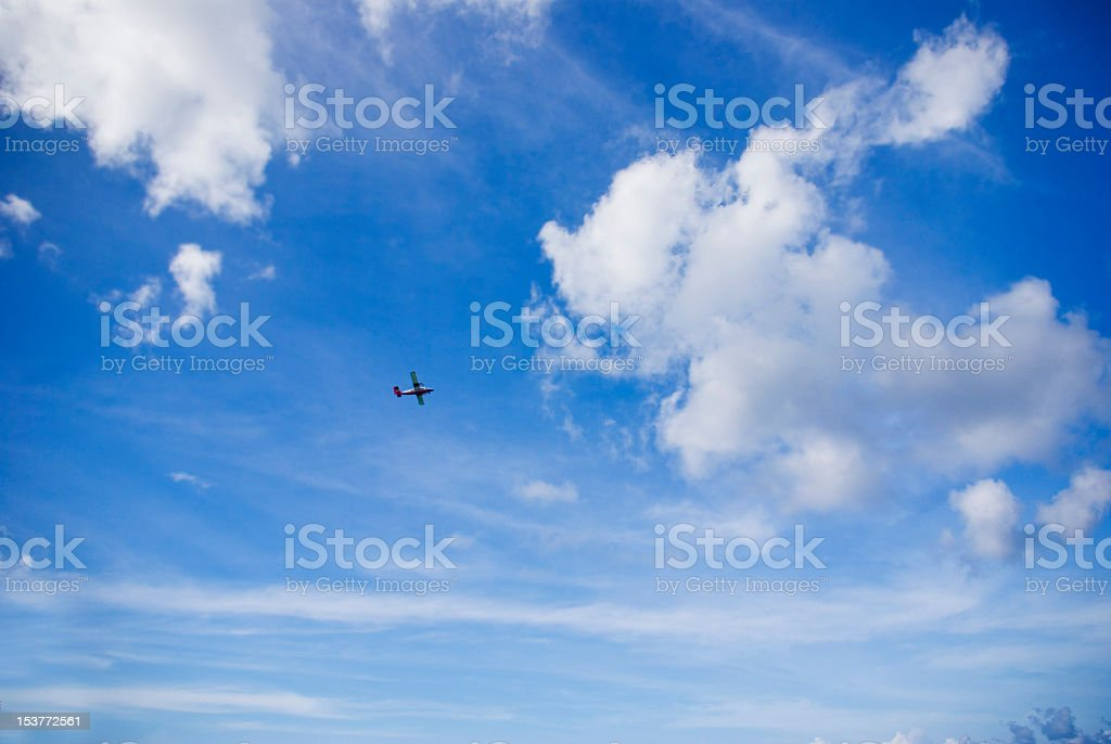 small aircraft in big blue sky stock photo