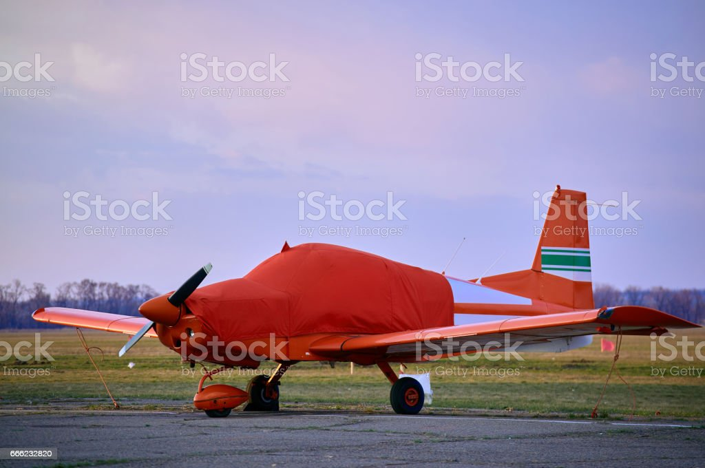 Small  aircraft in the parking lot of the airfield. stock photo