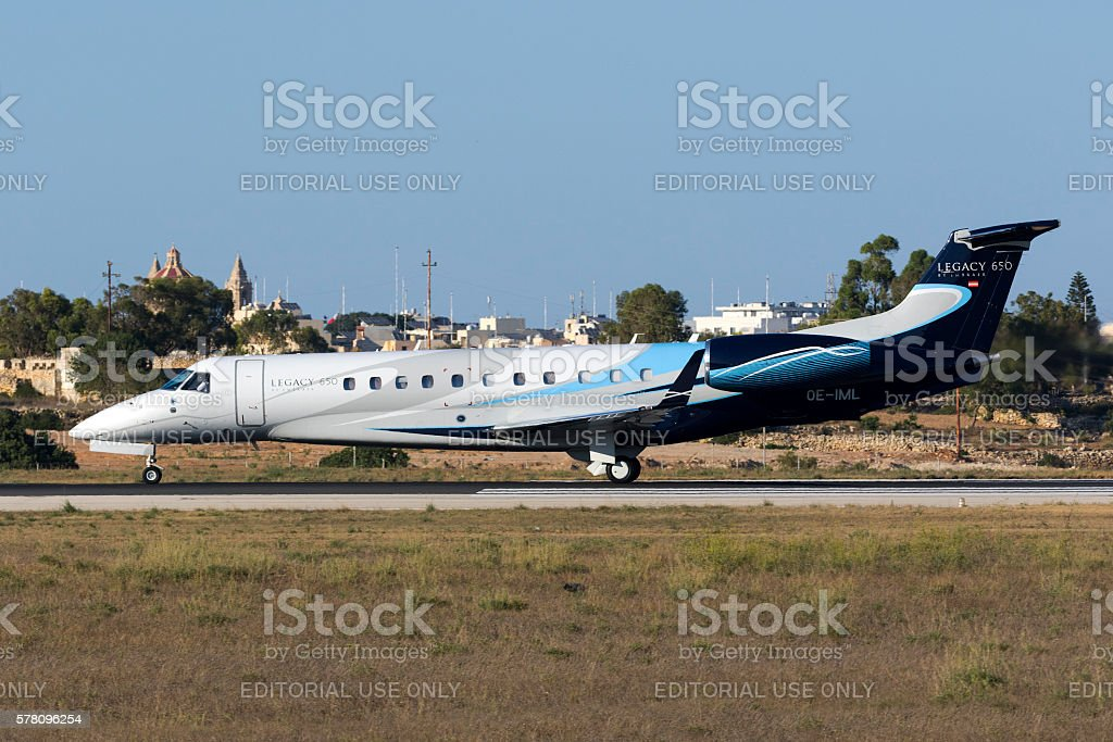 Small airliner on the runway stock photo