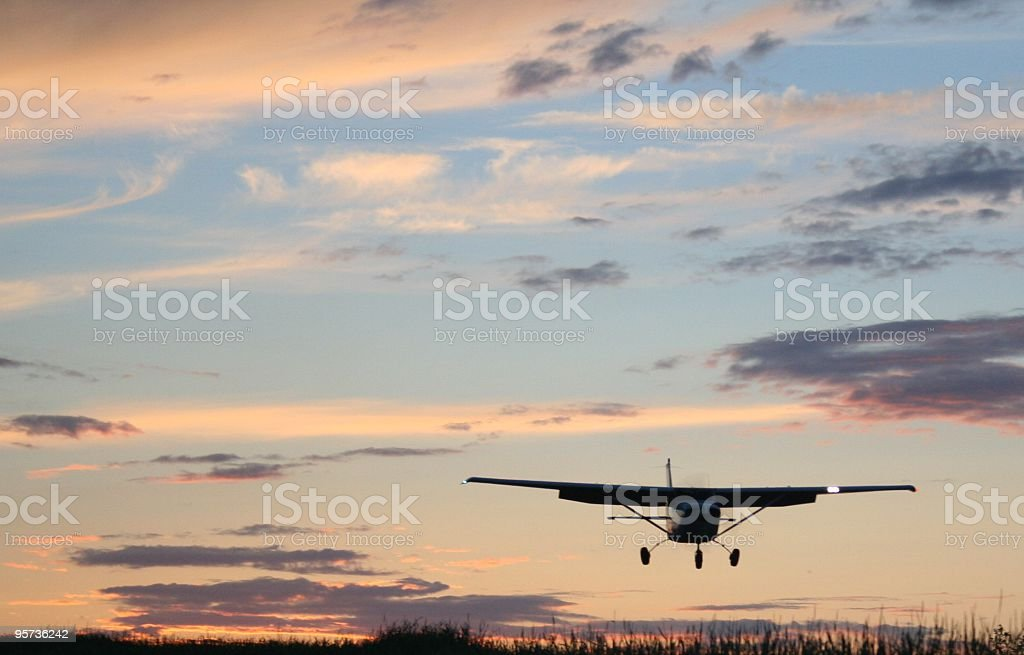 Small airplane at sunrise / sunset stock photo
