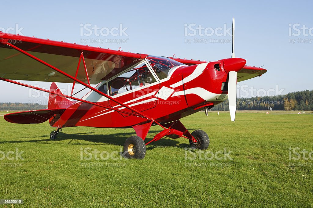 Small airplane on airfield grass stock photo