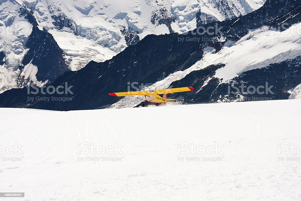 Small Airplane Starting On Snow royalty-free stock photo