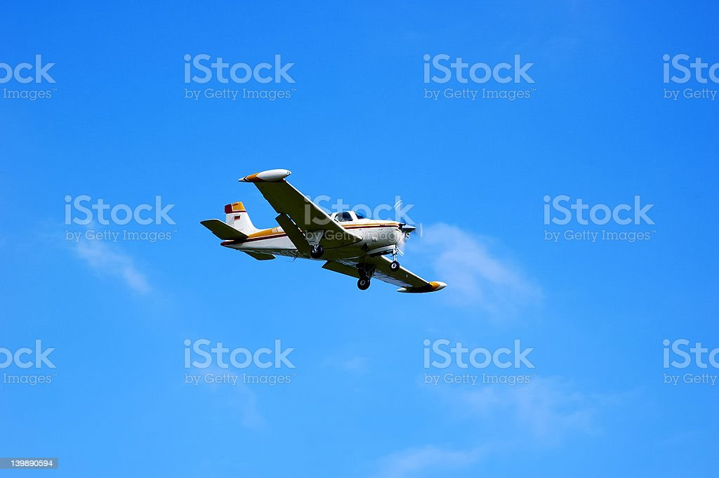 Small airplane with propeller is landing stock photo