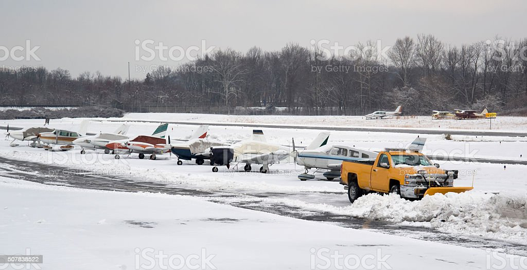 Small airport being snow plowed stock photo