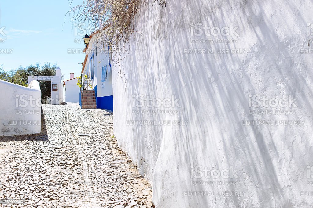 Small alley in the village of Mertola, Portugal. stock photo