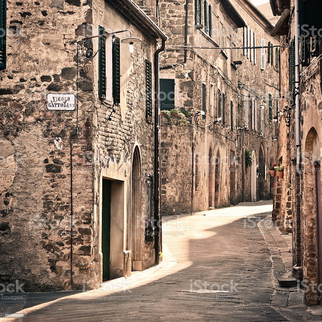 Small Alley of a Tuscan Village, Montalcino in Val d'Orcia royalty-free stock photo
