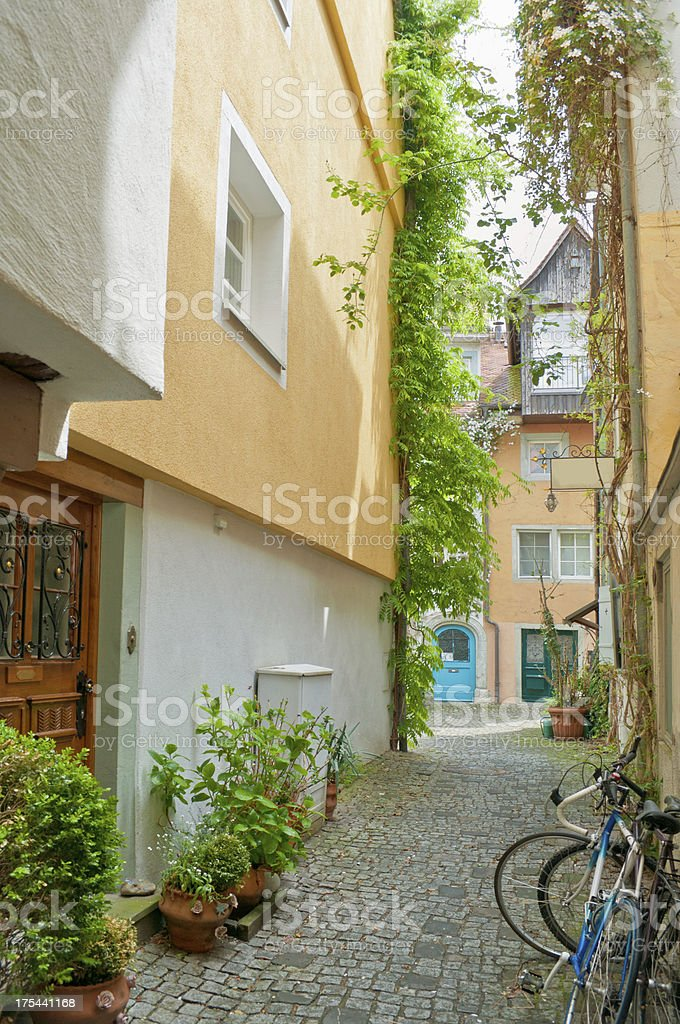 small alleyway between two historical houses royalty-free stock photo