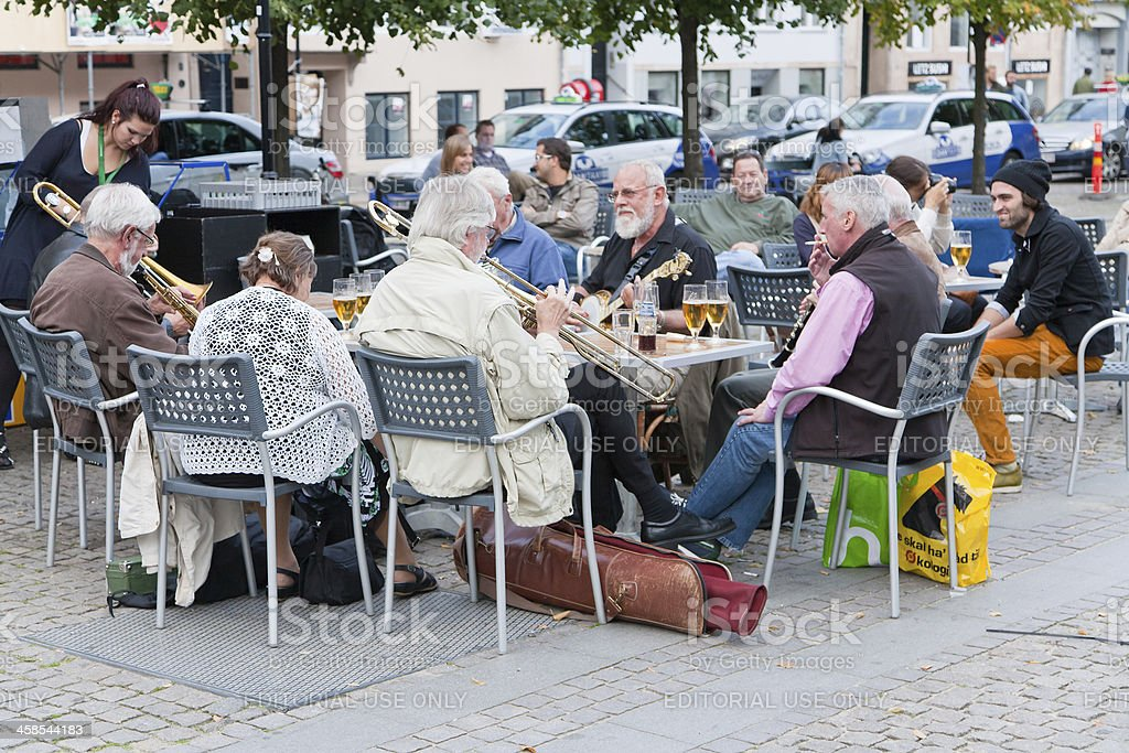 Small amateur jazz band in outdoor restaurant royalty-free stock photo