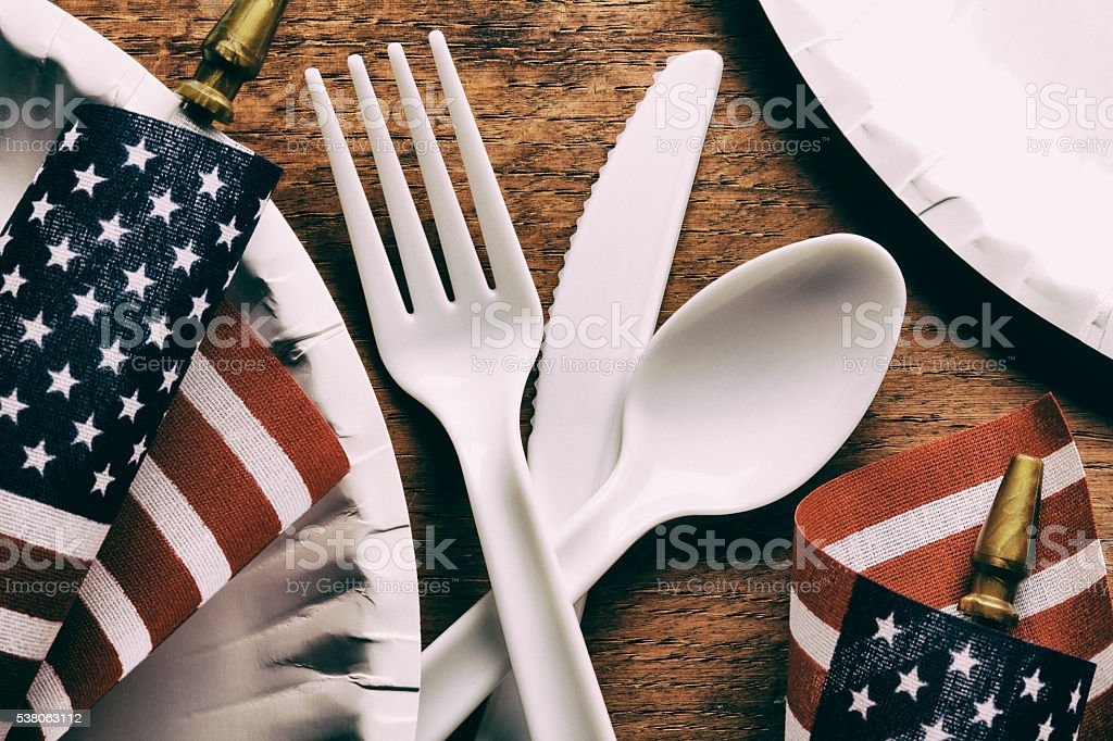 Small American Flags Sit Among A Picnic Table Seting stock photo