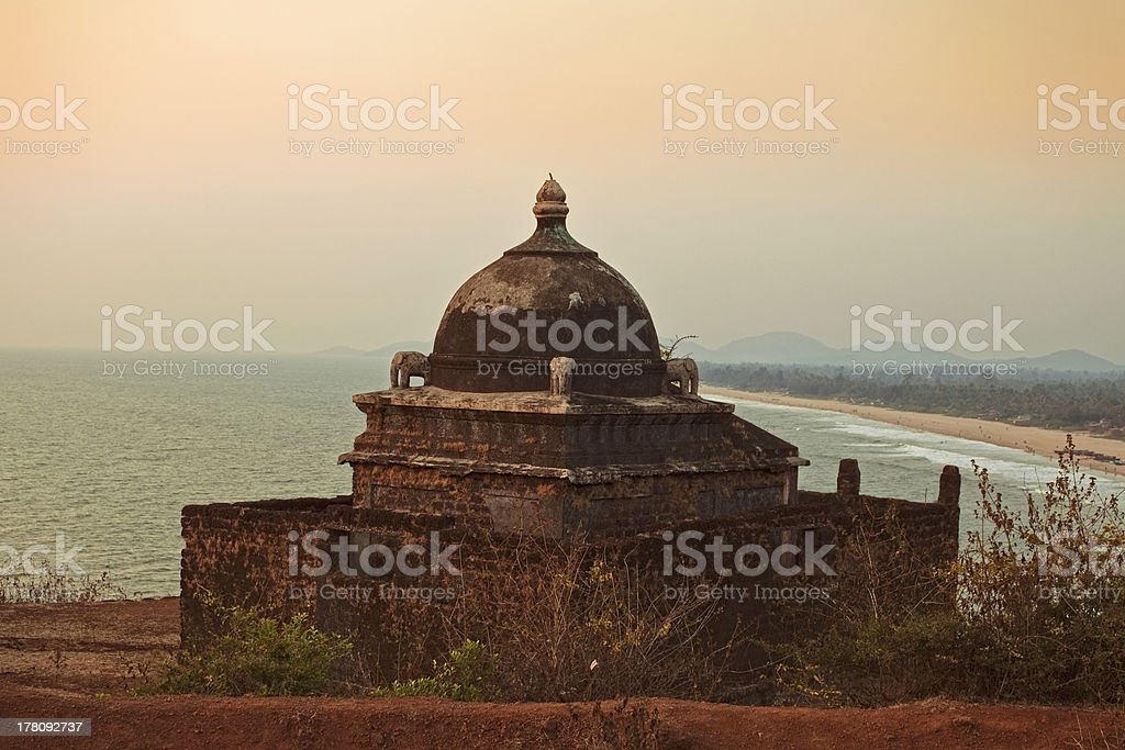 Small ancient Hindu temple by the sea royalty-free stock photo