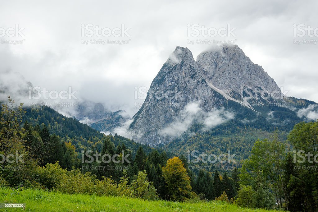 Small and Big Waxenstein Mountain befogged/ Bavaria stock photo