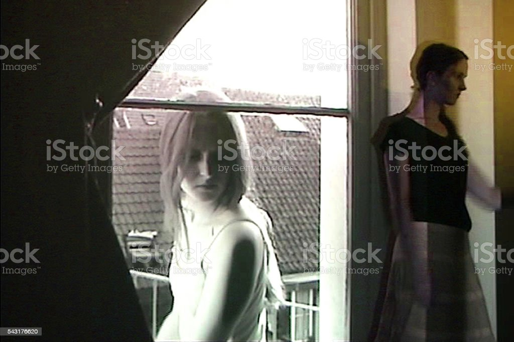 Small and big women in front of a window. stock photo