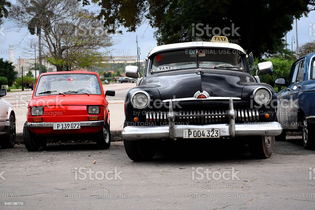 Small and large classic vehicle on the street in Havana stock photo