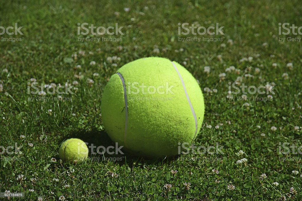 Small and large tennis balls stock photo