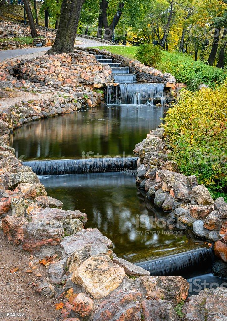 Small artificial waterfalls at Bastion Hill park in Riga, Latvia stock photo