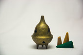 Small asian incense burner on white background.