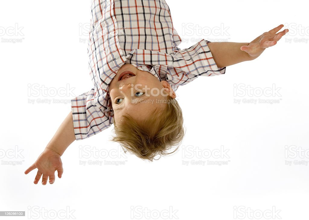 Small  baby boy hanging upside down on white royalty-free stock photo