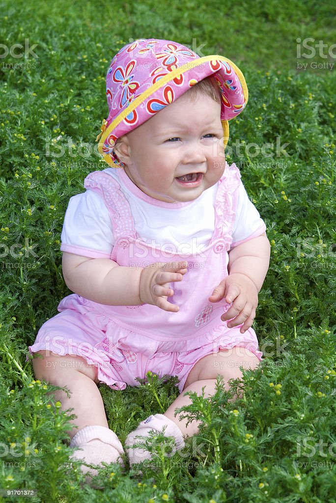 Small baby on green grass royalty-free stock photo