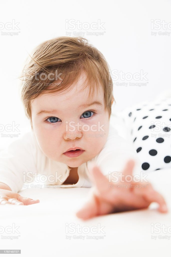 Small baby playing. Crawling. Reaching her parent. royalty-free stock photo