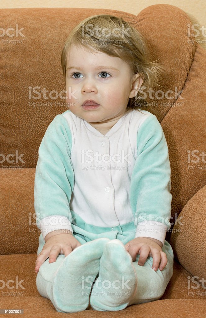 Small baby sitting in armchair royalty-free stock photo