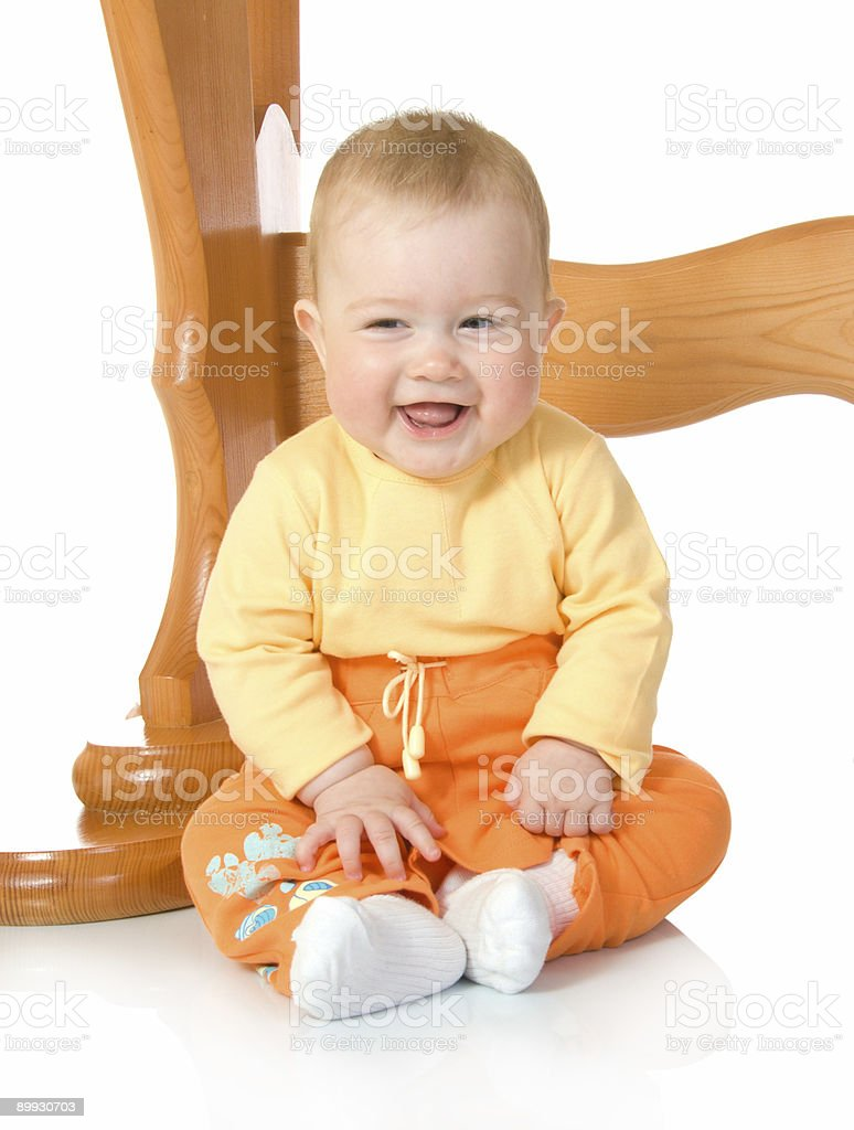 Small baby sitting with table isolated royalty-free stock photo