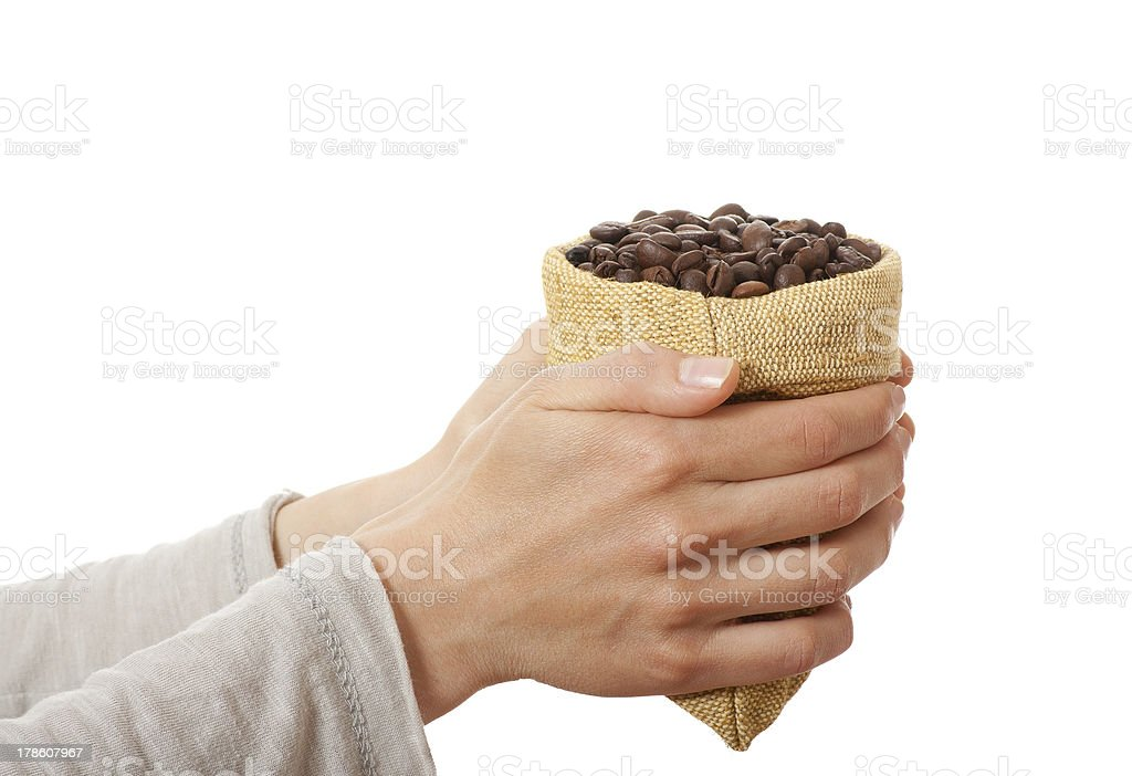 Small bag of coffee beans in female hands royalty-free stock photo