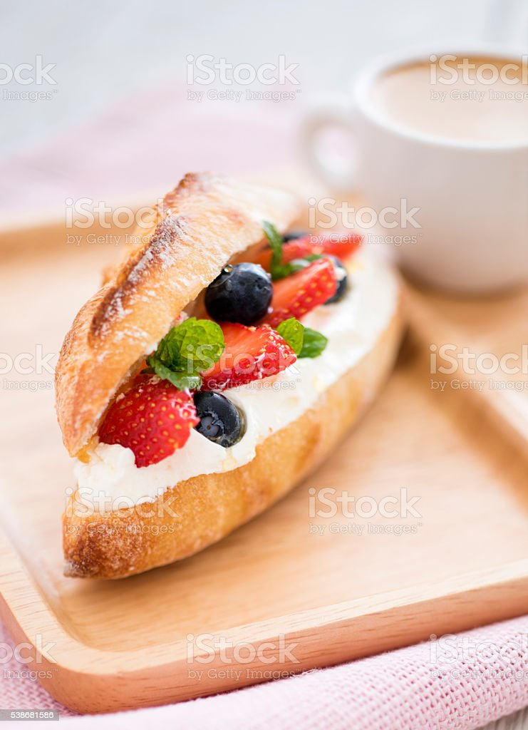 Small Baguette with Berries and Whip Cream stock photo