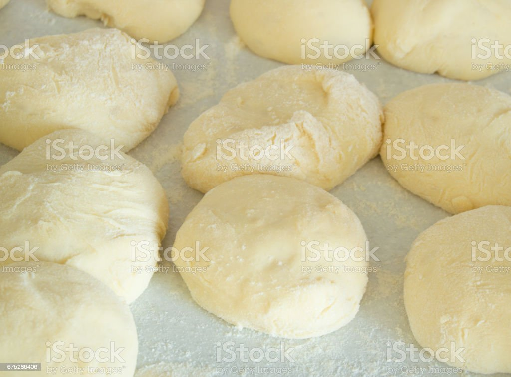 Small balls of dough with flour for cakes and biscuits, close up stock photo