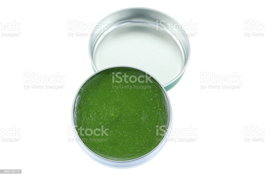 Small balm jar full of medicated ointment stock photo
