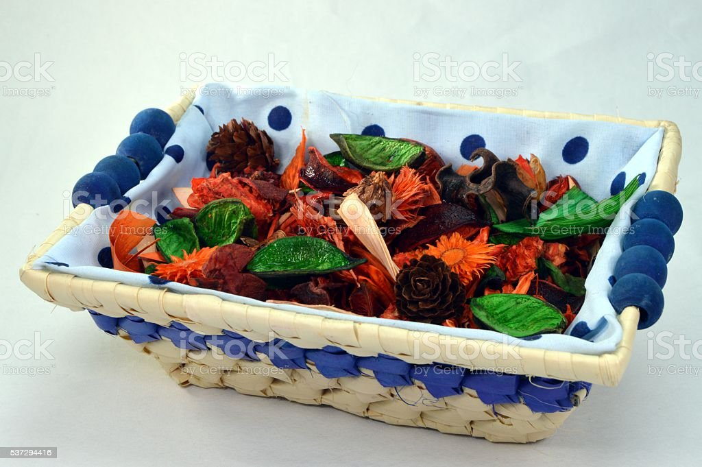 Small basket with flowers and plantes. stock photo