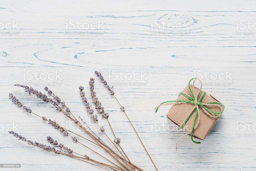 Small beautifully wrapped gift and lavender stock photo