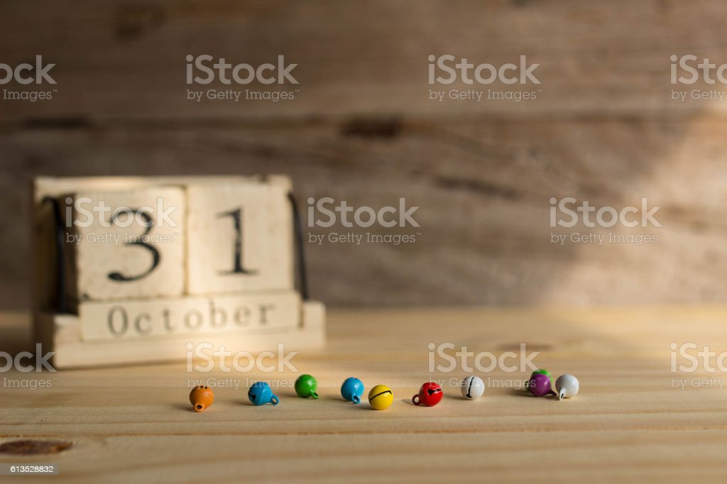 Small bell on wooden and wooden calendar in background stock photo