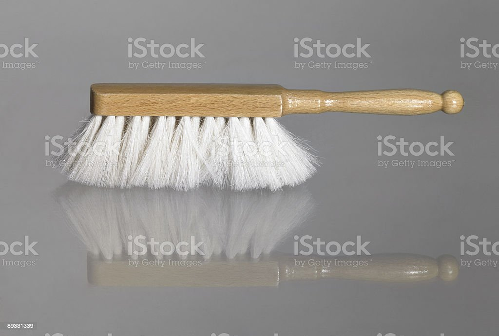 small besom on glass surface royalty-free stock photo