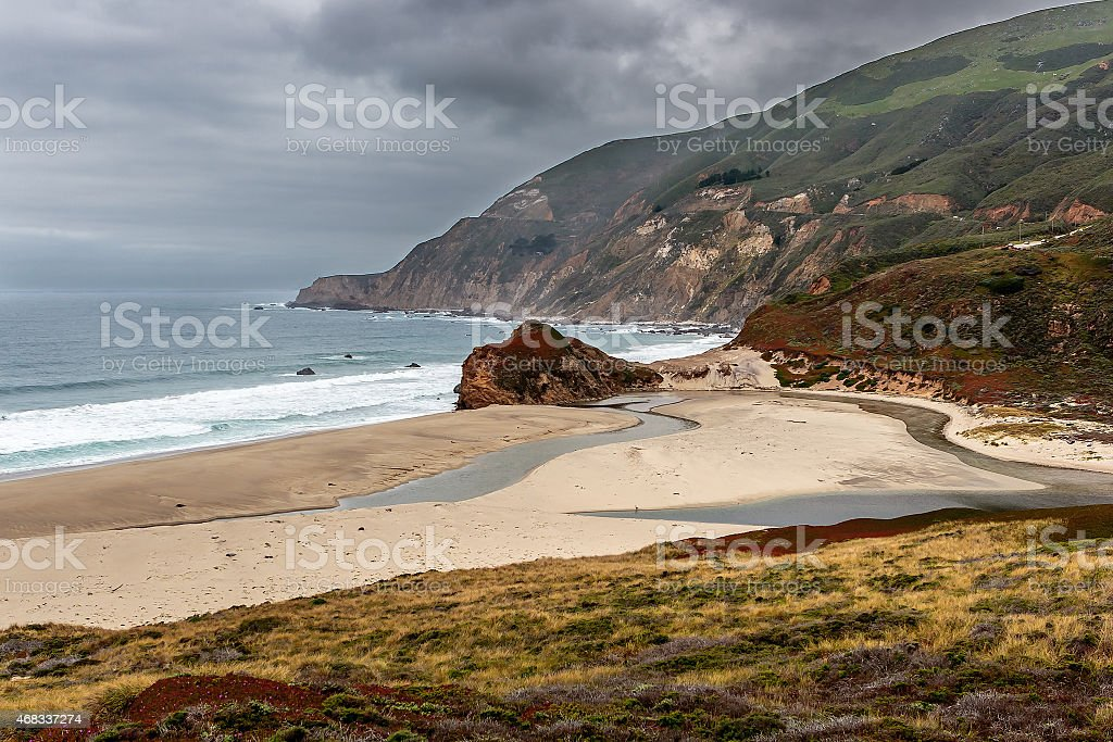 Small Big Sur beach in a cloudy day stock photo