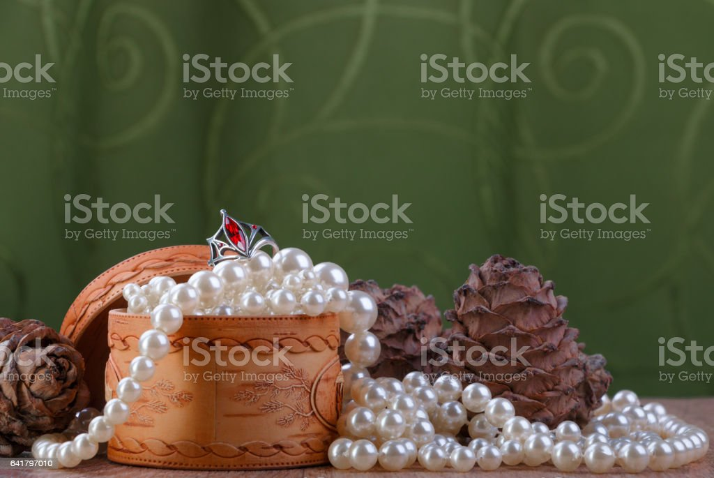 small birch bark casket with pearl beads and cedar cones stock photo