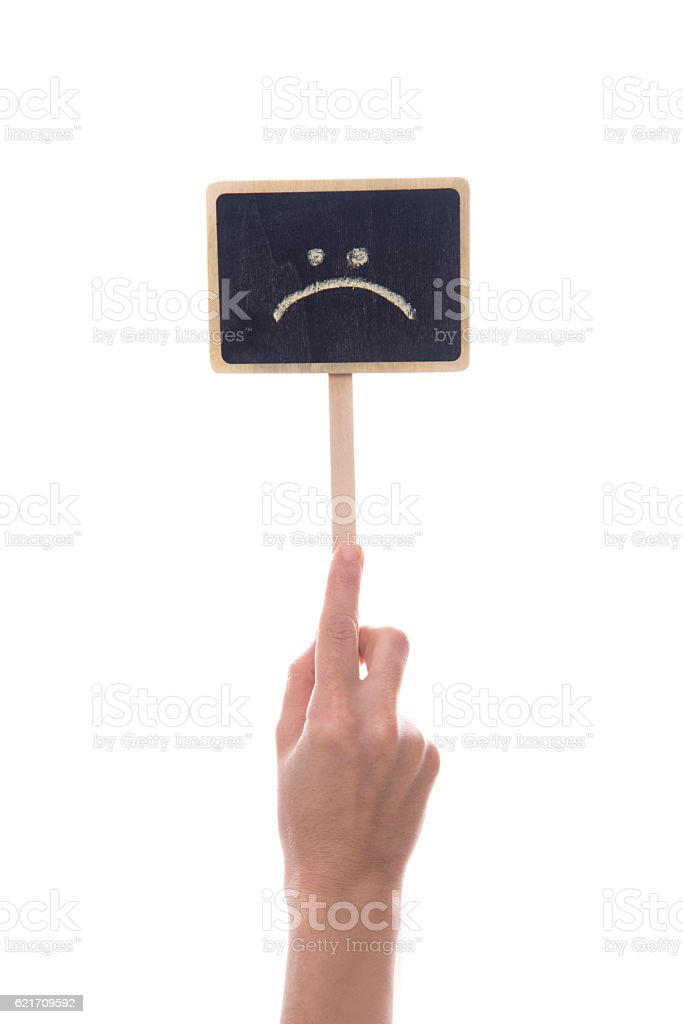 Small Black Board With The Sad Face Symbol stock photo