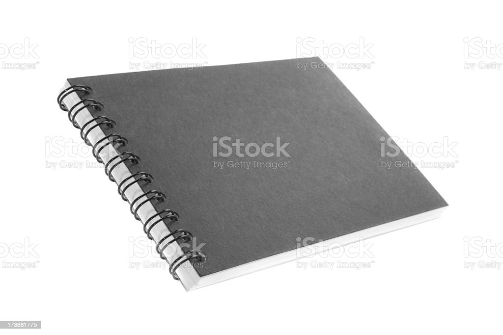 small black closed Spiral Notebook isolated royalty-free stock photo
