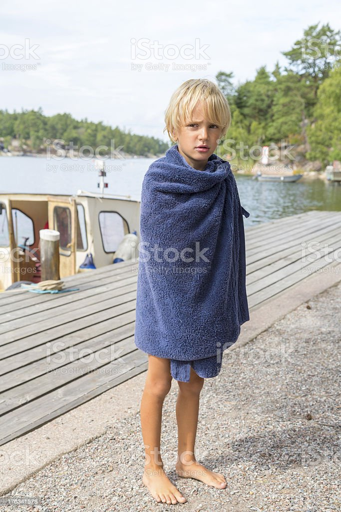 Small blond boy after a swim. Stockholm Archipelago. stock photo