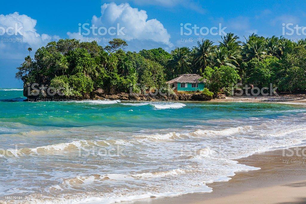 A small blue house on a sunny desert beach in Cuba stock photo