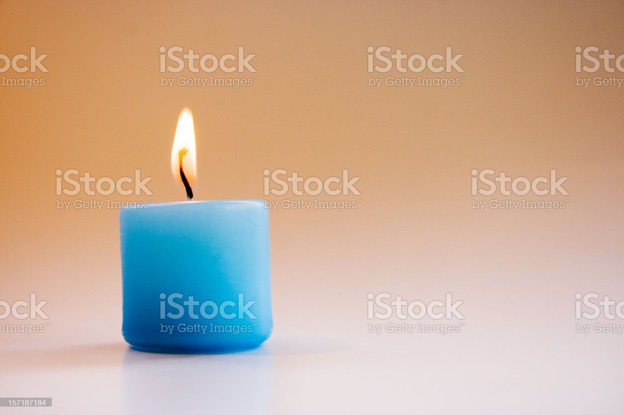 Small Blue Lighted Candle royalty-free stock photo