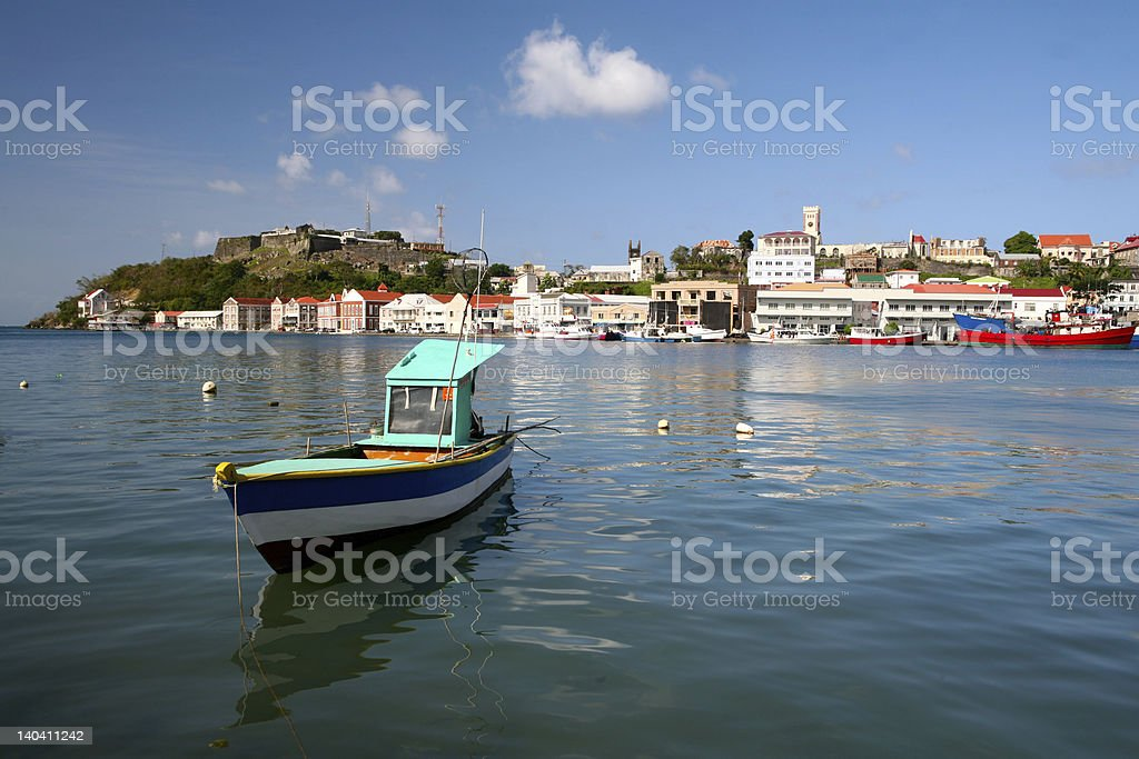 Small blue, white and aqua boat in the bay of Grenada royalty-free stock photo