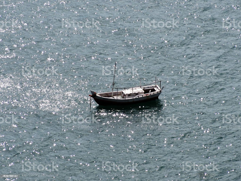 Small boat anchored at Bay of All Saints in Brazil stock photo