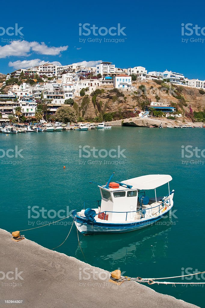 Small boat at Agia Galini Harbour stock photo